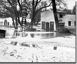 In March 1938 the Santa Ana River overtopped its banks and flooded a portion of northwest Riverside. Note the high water mark on the trees.