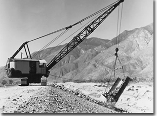 Placing rock revetment on the San Jacinto River Levee during its construction by the Corps of Engineers in 1961.
