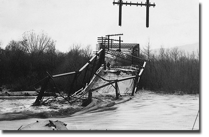 An old steel bridge over the Santa Ana River which collapsed during high flood flows on January 19, 1916.